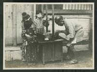 Children watching street food seller