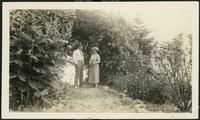 Martha and George Black on dirt walkway