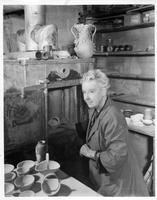 Hagen placing pottery in kiln