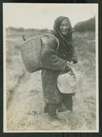 Aged farm worker standing in a field