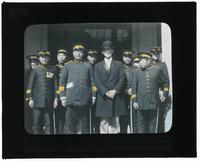 Commissioner of Police and staff members at public health exhibit headquarters in Canton [Guangzhou], China [Transparent]