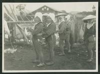 Construction crew erecting log dwelling