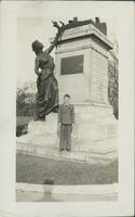 Child standing in front of Boer War monument.