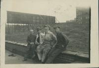 Harry Byers with 3 unidentified men at a construction site, side view.