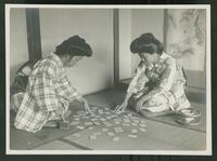 Seated women playing cards