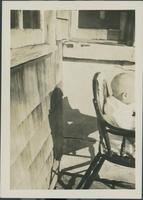 Unidentified infant outside.