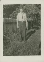 Harry Byers standing in a yard.