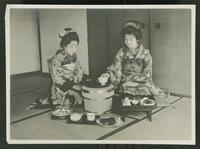 Two women formally sharing a meal for one