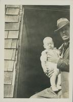 Harry Byers and an unidentified infant.