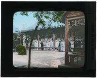 Group of men inspecting exhibits in Tientsin [Tianjin], China [Transparent]