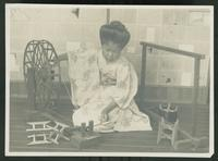 Seated woman spinning