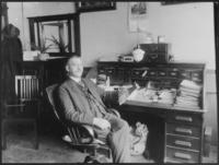 Doerr, C.H. sitting at desk