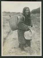 Aged farm worker standing in a field