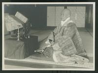 Seated Buddhist priest
