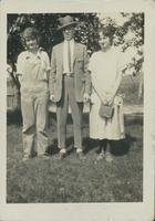 Harry Byers and 2 unidentified women standing on a lawn.