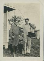 Harry Byers with an unidentified man, dressed in working clothes.