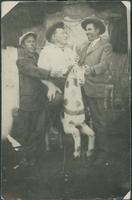 Harry Byers with two unidentified men and a carousel horse.