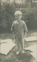 Lawson Holman standing in a backyard.
