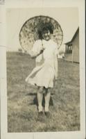 Jackie Bawman holding a parasol.